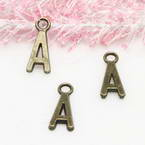 Charm, Metal alloy of copper, iron, tin, Bronze colour, 16mm x 7mm x 2mm