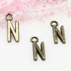 Charm, Metal alloy of copper, iron, tin, Bronze colour, 16mm x 6mm x 2mm